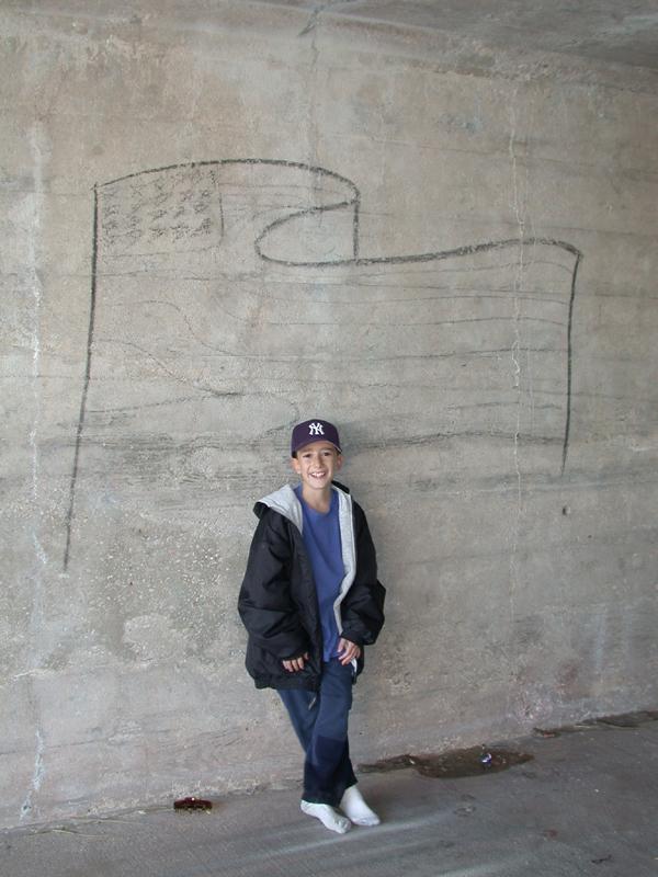 Danny with graffiti. Gilgo Beach. October 2001.